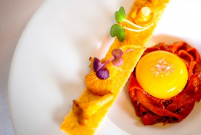 Egg yolk with peppers and chanterelles